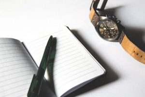 making a will - notebook and watch